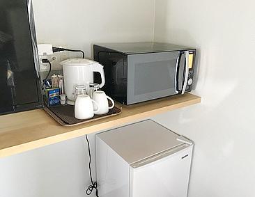 ペンショングスクの設備品の電子レンジ